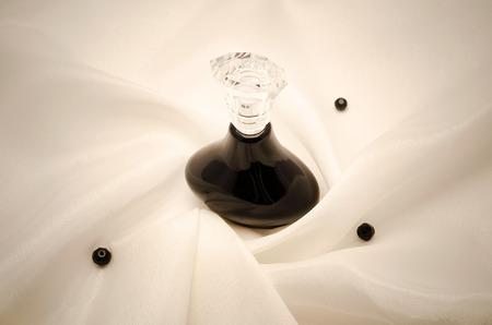 perfume bottle on fabric photo