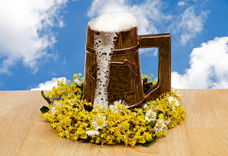 beer glass with flowers against the sky photo