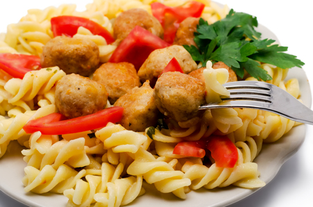 macaroni with meatballs and tomatoes the isolated photo