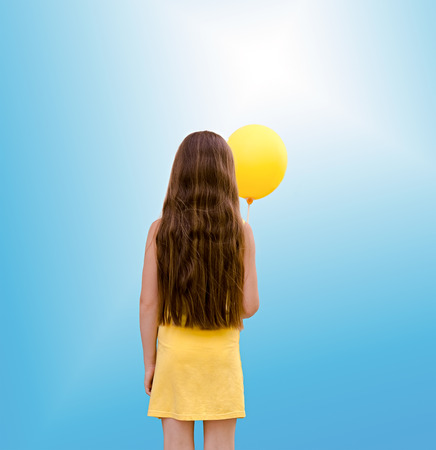 the child the girl with a balloon from a back photo