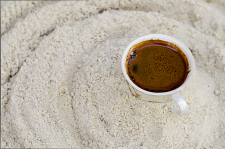 shortstop: one cup with coffee costs on sand