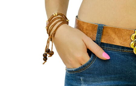 hands on pockets: hand with a bracelet in a pocket of jeans