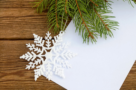 Christmas card with a sheet of paper and a snowflake photo