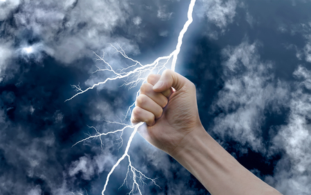 hand with a lightning photo