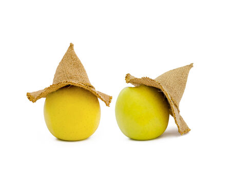 cartoon eating: apples in a hat