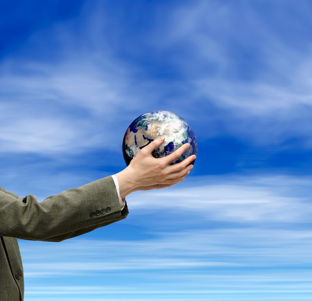 hands holding globe: an image of hands holding globe and sky. Elements of this image furnished by NASA.