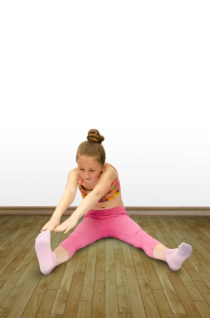 does: pretty little gymnast does exercises
