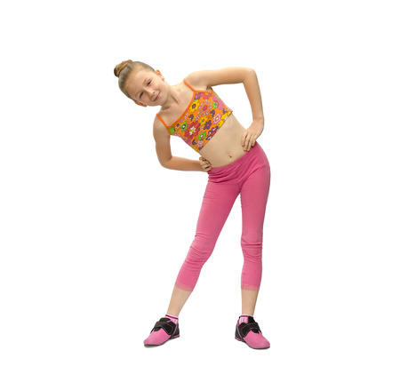 does: little girl does exercises on a white background