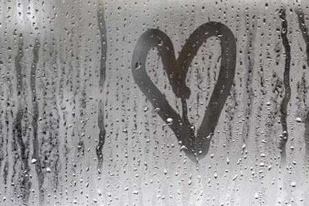 heart pattern on wet glass close-up