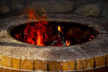fiery stone oven for baking bread in Georgia Archivio Fotografico