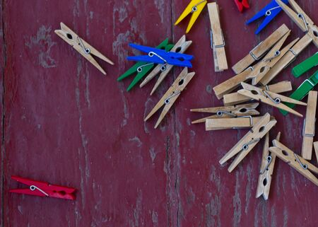 retro wooden clothespins on wood surface