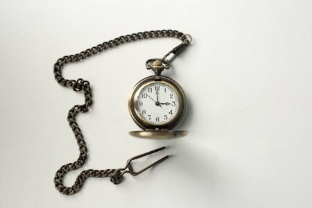 vintage old watch on a chain. hand holding a watch on a chain. vintage