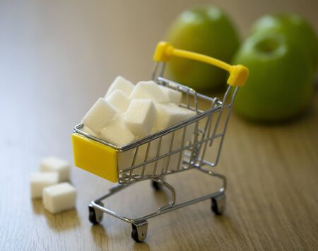 sugar in a grocery cart in light colors with partial blurring. conceptual photo about the harm of sugar to the body Archivio Fotografico
