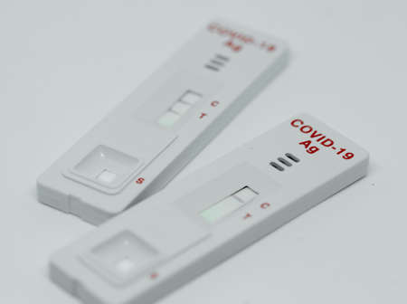 Positive testing for coronavirus isolated on white