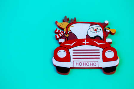 decor red Santa Claus car on a solid turquoise background close up Stock Photo