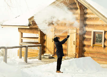 boiling water splashed out of a mug in the cold minus 35 degrees turns into steam. a teenager explores the transformation of boiling water into steam in the extreme cold, in winter