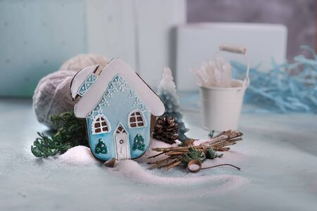 Gingerbread gingerbread in the form of decorated house. Turquoise. Sugar and sugar icing. On a blue background