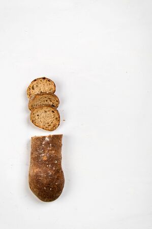 cut into slices of a loaf of dark bread made from rye flour