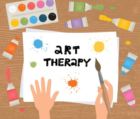 Art therapy. Hands, brush, paint, sheet of paper on a wooden background. EPS10