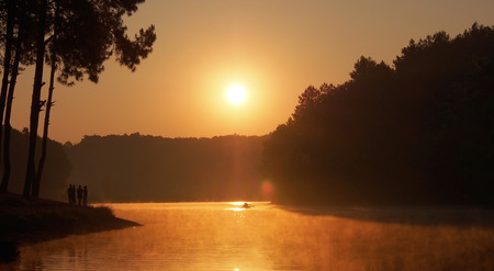 sculling: Silhouette of four friends and one sculling boat on Sunrise time