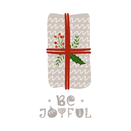 Christmas greeting card with gift and lettering.