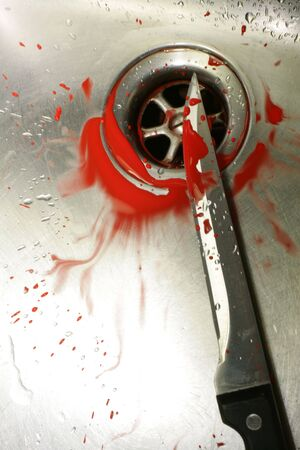 evocative: A bloody knife in a stainless steel sink. Evocative of a murder scene, washing the evidence away.