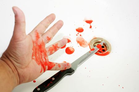 bloodied: A bloodied hand over a bloodied knife set on a white background with blood splatters over a plug hole in a sink.
