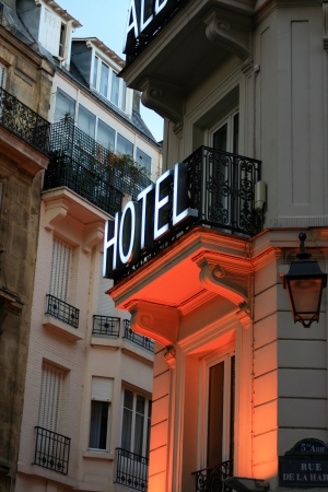 hotel building: Hotel sign in Latin Quarter of Paris France with orange neon glow underneath. Stock Photo