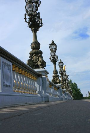 Pont Alexandre II bridge in Paris France. Low angled view across bridge.