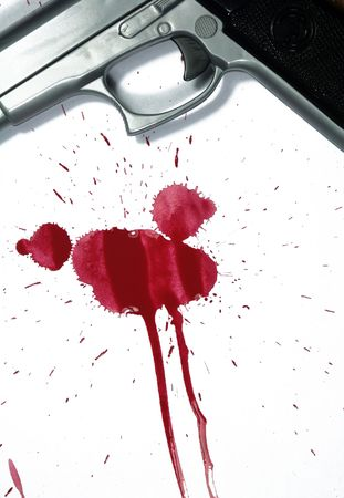 Hand gun and blood splatter. Murder Scene