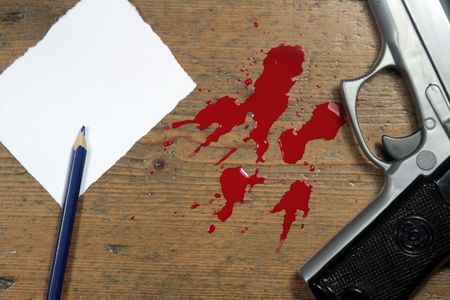Gun and blood splatters next to a blank note and pencil (copy space)