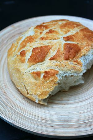 campagne: Traditional French white Pain De Campagne bread set on an oval wooden platter.