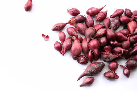 baron: A landscape format image of a pile of Red Baron onion sets, set on a white isolated background. Stock Photo
