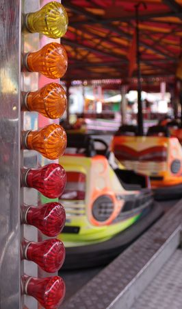 A set of coloured lights decorating a dodgem stand at a local funfair.