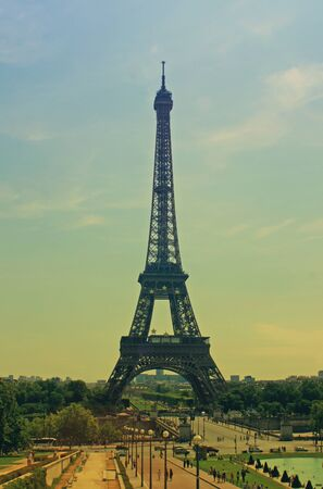 evocative: The Eiffel Tower in Paris France with a retro effect applied evocative of the 1960s period.