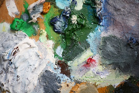 Close up detail of an artists pallet with oil paints creating an abstract pattern background, set on a landscape format. Stock Photo - 13180075