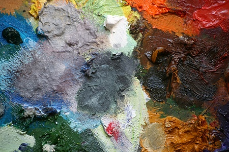 painter palette: Close up detail of an artists pallet with oil paints creating an abstract pattern background, set on a landscape format.