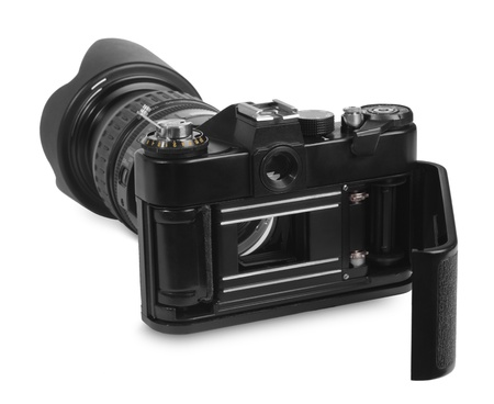Vintage professional 35mm film camera, with a modern zoom lens, ready for use Stock Photo - 9389242