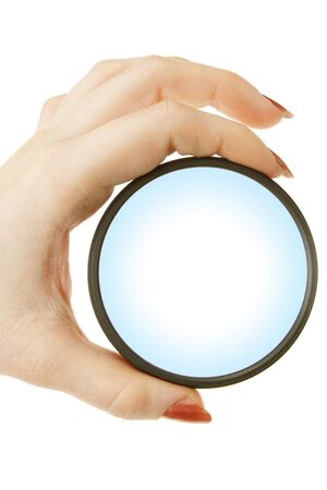 a girl holds in her hand magnifying glass on a white background