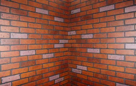 corner of the brick wall, bricks are directed toward the center of the corner