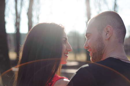 Young beautiful couple in love posing outdoor in city. Young wom Stock Photo