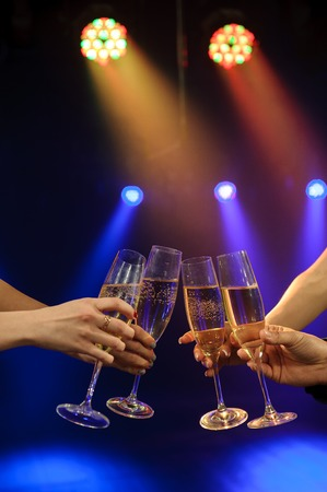 People with champagne in a bar or casino having lots of fun.