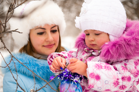 Mother and her little daughter enjoying beautiful winter day Stock Photo