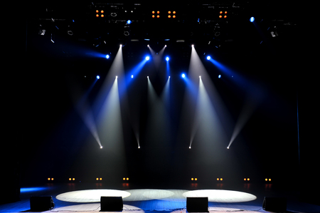 Free stage with lights, lighting devices as background. Фото со стока