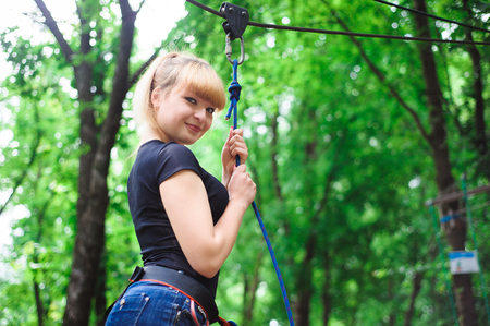 Hiking in the rope park beautiful sports girl
