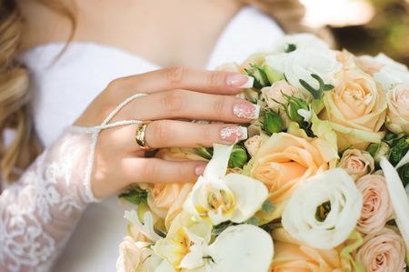 Trouwdetails - bruidsboeket van een bruid Stockfoto