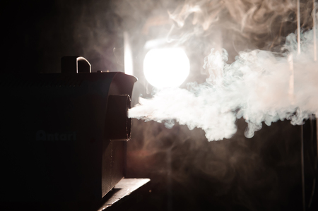 smoke machine in action in the darkness Imagens
