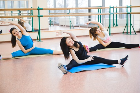 Group of people at the gym in a stretching class