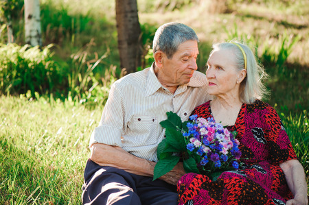 beautiful happy old people sitting in the park.