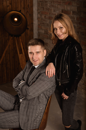 Studio shot of beautiful young couple with smile